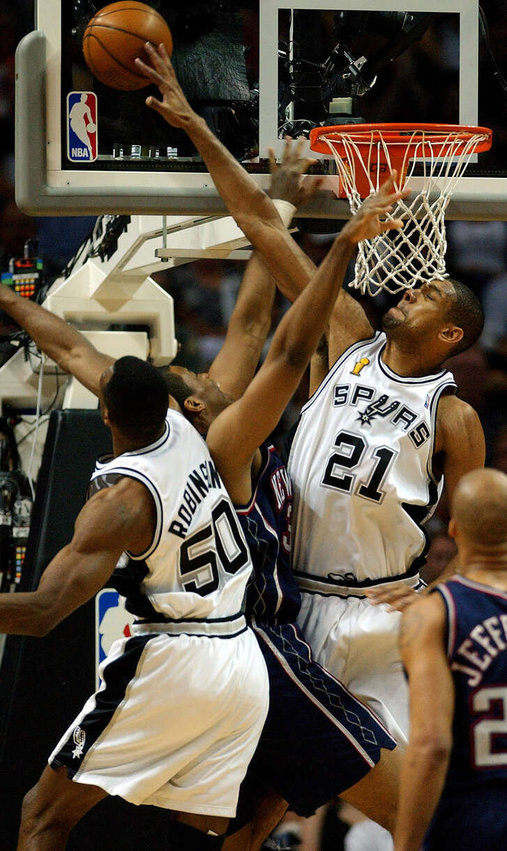 Spurs' Tim Duncan (21) and David Robinson combine to block Nets' Jason Collins during first quarter action of Game 6 of the NBA Finals at the SBC Center in San Antonio on June 15, 2003.