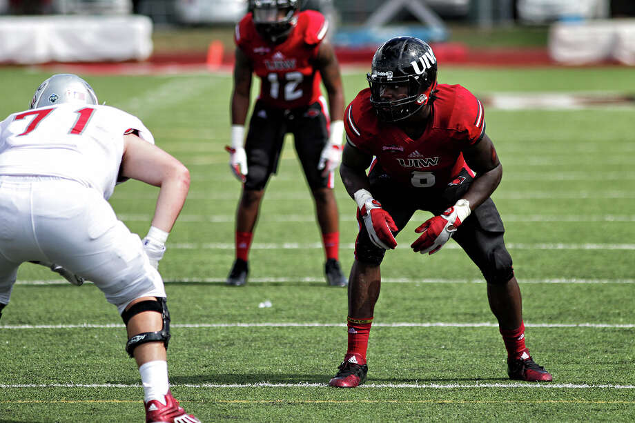Incarnate Word linebacker Myke Tavarres lines up to rush the passer during a 2015 game against Nicholls State at Benson Stadium in San Antonio. Photo: Courtesy Photo / UIW Athletics / Captured Keepsakes 2001-present