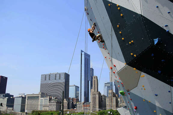 An adventurer scales one of the two rock-climbing walls in downtown Chicago's Maggie Daley Park.  An adventurer scales one of the two rock-climbing walls in downtown Chicago's Maggie Daley Park.