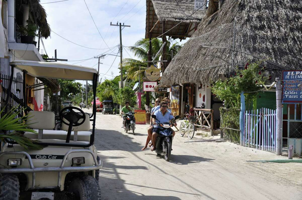The palm-thatched huts and brightly painted houses lining the sand streets of Mexico's Isla Holbox have been joined in recent years by shops, restaurants and hotels.