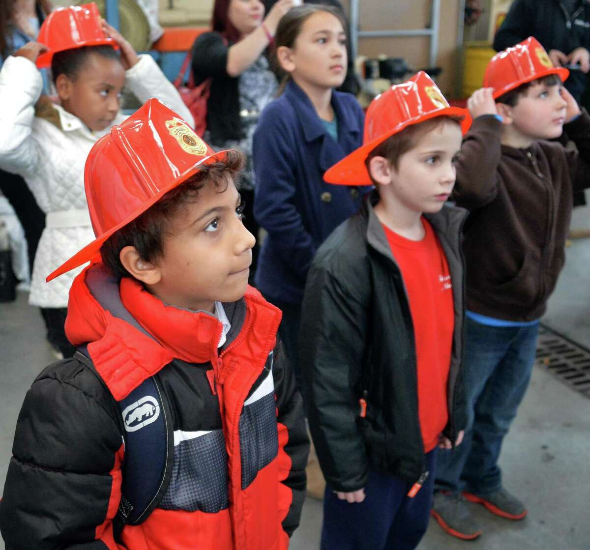 Ilan Payan, left, and other fire prevention poster contest winners from schools throughout the city tour the Troy Central Fire House Friday Nov. 13, 2015 in Troy, NY. (John Carl D'Annibale / Times Union)