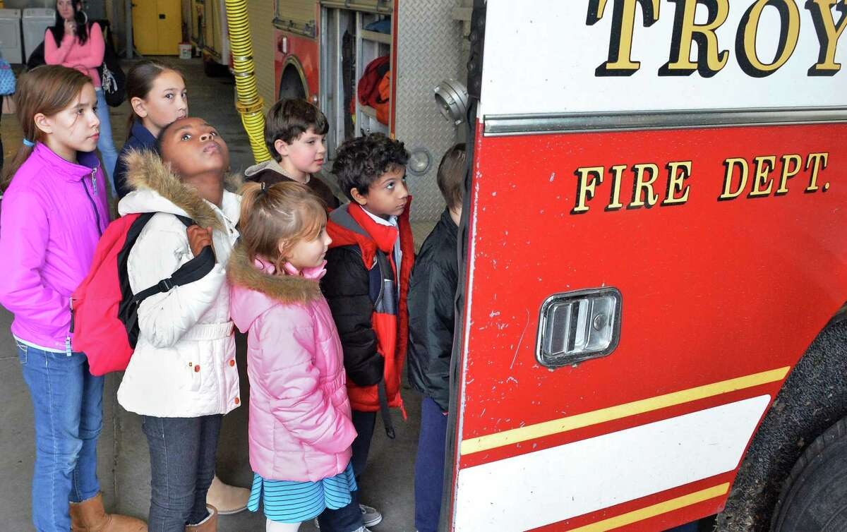 Annual fire prevention poster contest winners from schools throughout the city tour the Troy Central Fire House Friday Nov. 13, 2015 in Troy, NY. (John Carl D'Annibale / Times Union)
