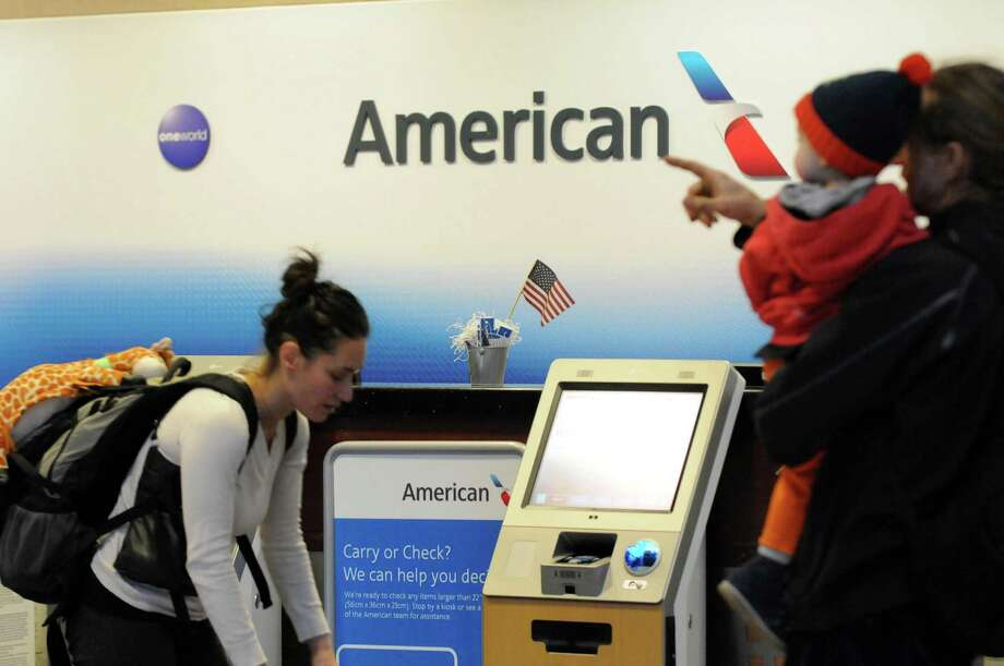 The American Airline ticket counter at Albany International Airport on Friday Nov.13, 2015 in Colonie, N.Y. American Airline revives its nonstop service to Chicago, seven years after they ceased. Three direct flights to Chicago-O'Hare Airport will begin March 3, 2016. (Michael P. Farrell/Times Union) Photo: Michael P. Farrell / 00034255A
