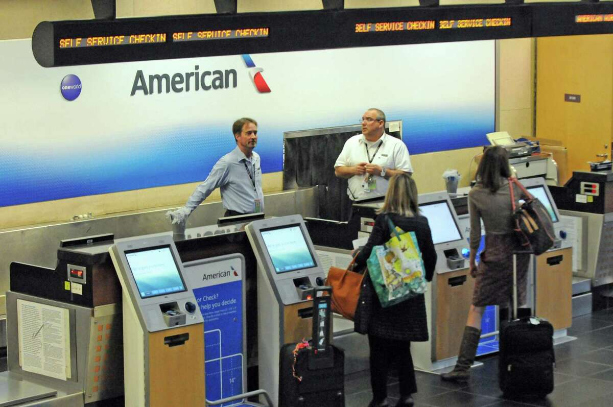 The American Airline ticket counter at Albany International Airport on Friday Nov.13, 2015 in Colonie, N.Y. American Airline revives its nonstop service to Chicago, seven years after they ceased. Three direct flights to Chicago-O?'Hare Airport will begin March 3, 2016. (Michael P. Farrell/Times Union)