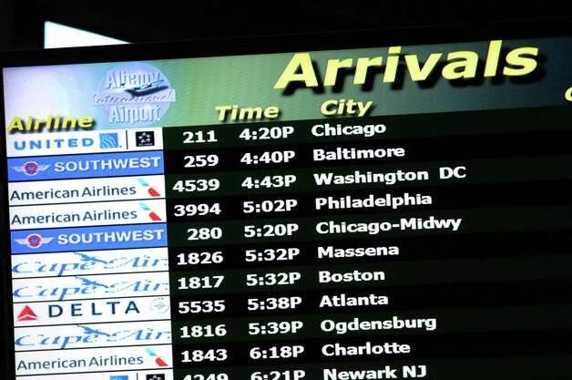 Arrivals screen at  Albany International Airport on Friday Nov.13, 2015 in Colonie, N.Y. American Airline revives its nonstop service to Chicago, seven years after they ceased. Three direct flights to Chicago-O'Hare Airport will begin March 3, 2016. (Michael P. Farrell/Times Union) Photo: Michael P. Farrell / 00034255A