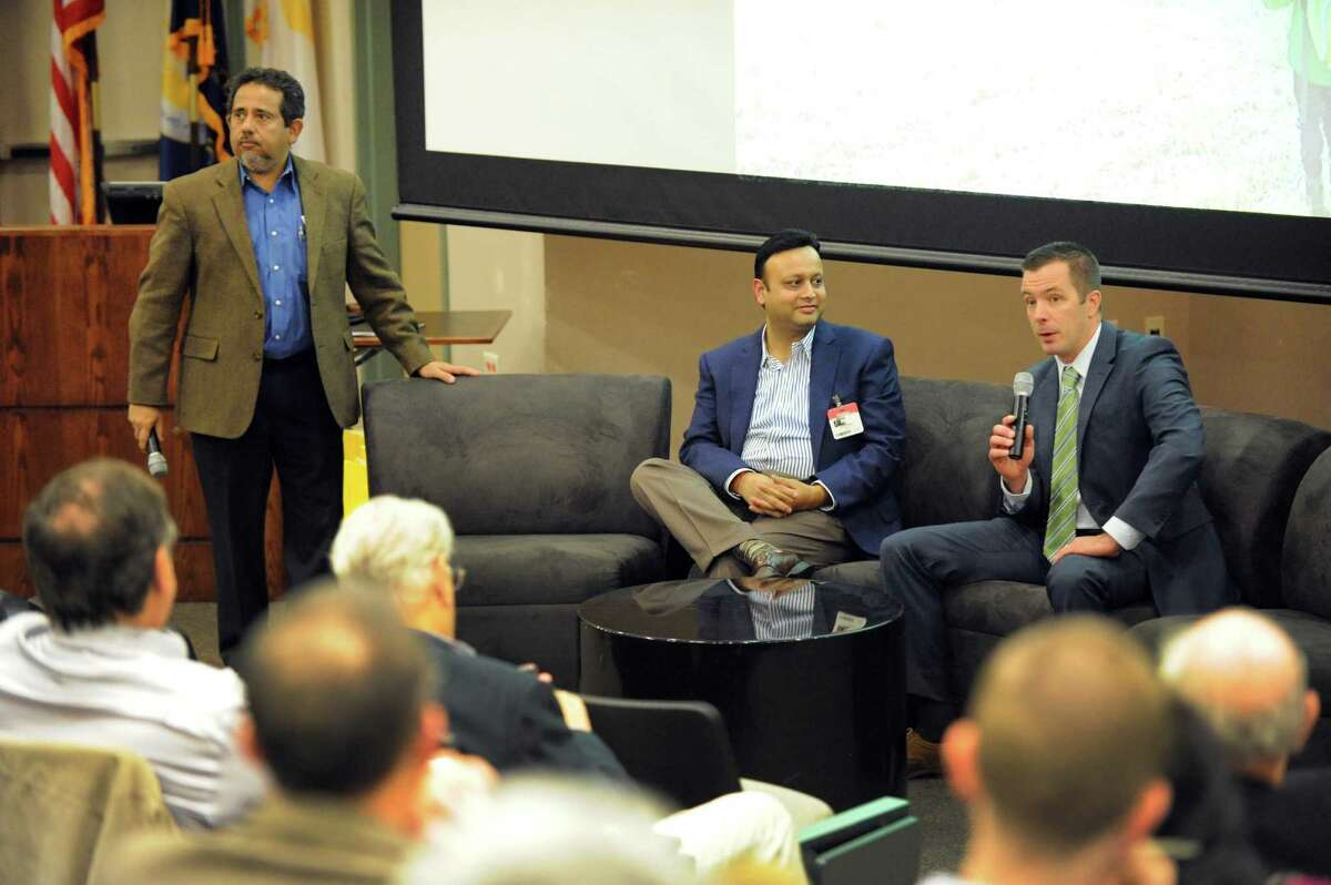 Pradeep Haldar, left, Interim Dean of the College of Nanoscale Engineering and Technology Innovation and CNSE Vice President of Entrepreneurship Innovation and Clean Energy Programs, Vikash Agrawal, center, Chairman & Co-founder of Etransmedia Technology and Chris Covell, President and CEO of SmartWatt Energy take part in the SPARC Entrepreneurship Forum at SUNY Poly on Thursday Nov.12, 2015 in Albany, N.Y. (Michael P. Farrell/Times Union)