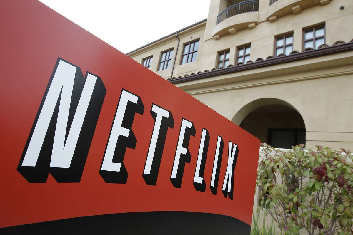 """FILE - This March 20, 2012 file photo shows Netfilx headquarters in Los Gatos, Calif. Netflix on Thursday, Oct. 8, 2015 announced it is raising the price of its Internet video service by $1 in the U.S. and several other countries to help cover its escalating costs for shows such as """"House of Cards"""" and other original programming. (AP Photo/Paul Sakuma, File)"""