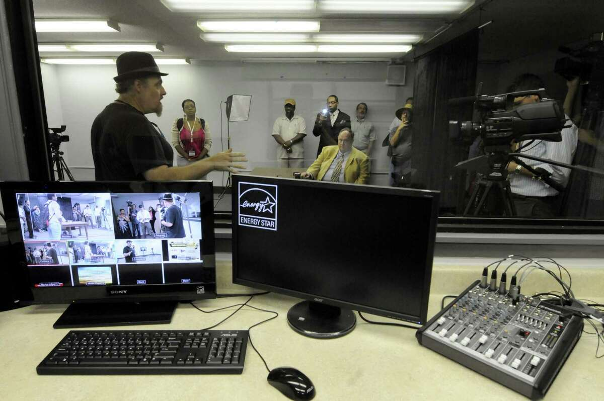 Station access coordinator Joe Piazzo, left, gives a tour of Channel Albany Community Broadcasting studio at the Albany Public Library in Albany N.Y. Wednesday July 11, 2012. (Michael P. Farrell/Times Union)