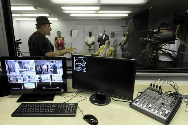 Station access coordinator Joe Piazzo, left, gives a tour of Channel Albany Community Broadcasting studio at the Albany Public Library in Albany N.Y. Wednesday  July 11, 2012. (Michael P. Farrell/Times Union) Photo: Michael P. Farrell / 00018421A