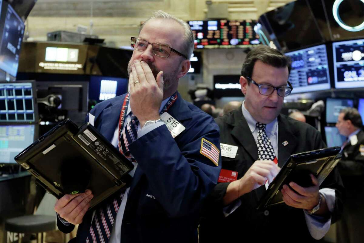 Traders David O'Day, left, and Benedict Willis work on the floor of the New York Stock Exchange, Friday, Nov. 13, 2015. Sharp declines in retailers were dragging the stock market lower in early trading as investors worry that holiday sales could slump. (AP Photo/Richard Drew) ORG XMIT: NYRD110