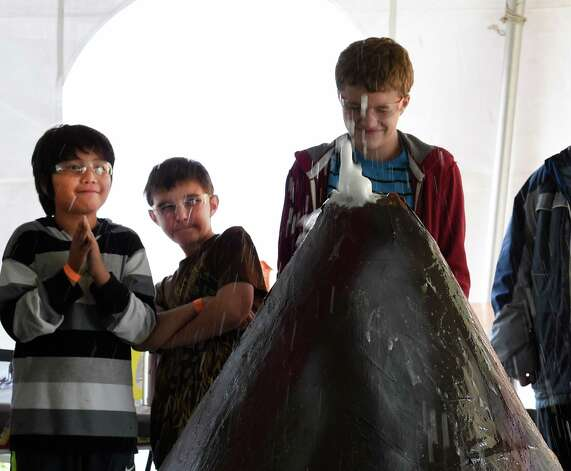 Grade school students react to the eruption of a man made volcano at the Science Festival held at the Museum of Innovation and Science Nov. 13, 2015 in Schenectady, N.Y.  The Science Festival runs through Sunday at the Museum.  (Skip Dickstein/Times Union) Photo: SKIP DICKSTEIN / 00034237A