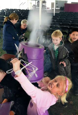 Brieanna Chandler, 9 of the Abraham Wing School of Glens Falls participates in a demonstration of air vortex by making fog rings at the Science Festival held at the Museum of Innovation and Science Nov. 13, 2015 in Schenectady, N.Y.  The Science Festival runs through Sunday at the Museum.  (Skip Dickstein/Times Union) Photo: SKIP DICKSTEIN / 00034237A