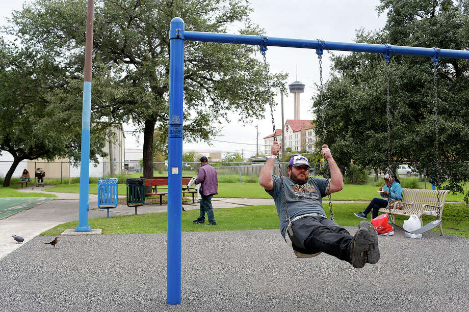 Edward Watt swings at the near East Side park. The owner of a adjacent hotel has offered to buy the city-owned park. Photo: Lisa Krantz / San Antonio Express-News / © 2015 San Antonio Express-News