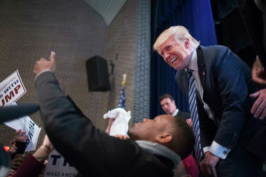 FORT DODGE, IA - NOVEMBER 12:  Republican presidential candidate Donald Trump greets guests during a campaign stop at Iowa Central Community College on November 12, 2015 in Fort Dodge, Iowa. The stop comes on the heals of Tuesday's eight-candidate Republican debate in Milwaukee where a national poll of viewers declared Trump the winner.  (Photo by Scott Olson/Getty Images) Photo: Scott Olson, Staff / Getty Images / 2015 Getty Images