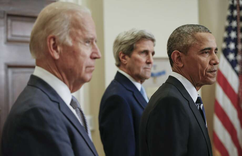 President Barack Obama (right) standing with Secretary of State John Kerry (center) and Vice President Joe Biden, makes a statement on the Keystone Pipeline from the Roosevelt Room at the White House. Photo: Pablo Martinez Monsivais, Associated Press