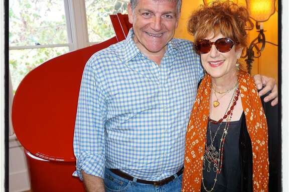 Afonso Montuori and his wife, jazz artist Kitty Margolis at McEvoy Ranch with the red baby Grand that once belonged to Elton John. Oct 2015.