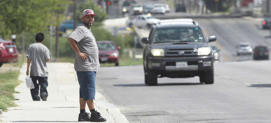 A pedestrian prepares Wednesday October 7, 2015 to cross seven lanes of traffic at the intersection of Culebra and Navidad. Photo: John Davenport, Staff / San Antonio Express-News / ©San Antonio Express-News/John Davenport