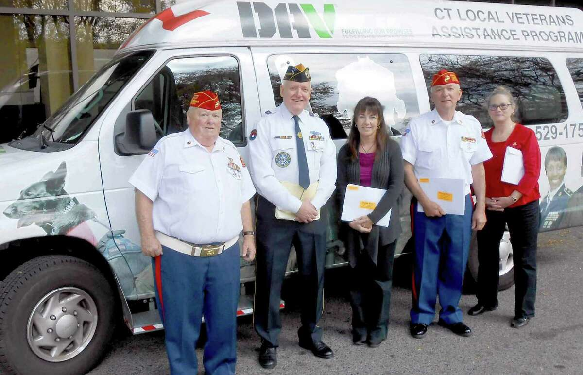From left, Capt. Tim Huff, Al Meadows, Kathy Granfield, Vic Carroll and Bonnie Adams visit wounded troops at the Walter Reed National Military Hospital in Bethesda, Md. Huff, Meadows, Carroll and Adams are members of Stamford Disabled American Veterans Chapter 13.