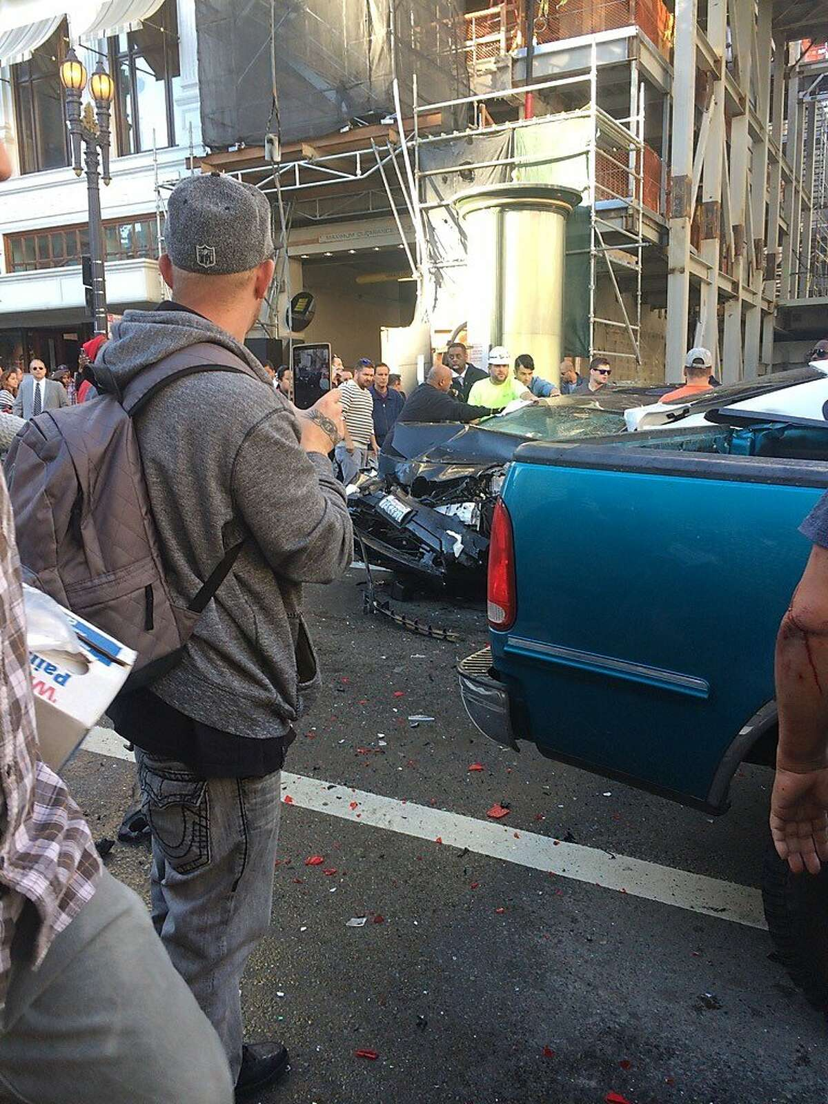 Seven people were reportedly injured after scaffolding collapsed when a tour bus made contact with it at the new Apple store location which is under construction at Stockton and Post streets on Friday, Nov. 13, 2015 in San Francisco, Calif.