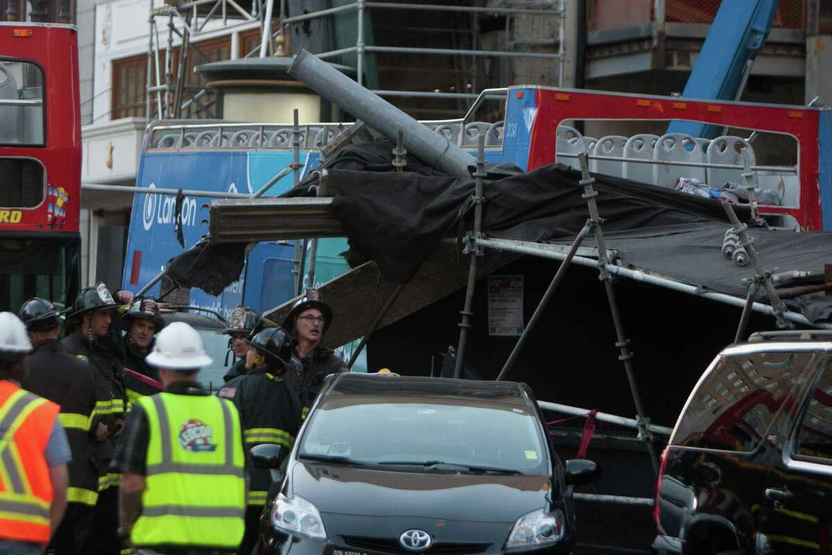 The scene after a tour bus crashed into several cars near Union Square in San Francisco on Friday, November 13, 2015.