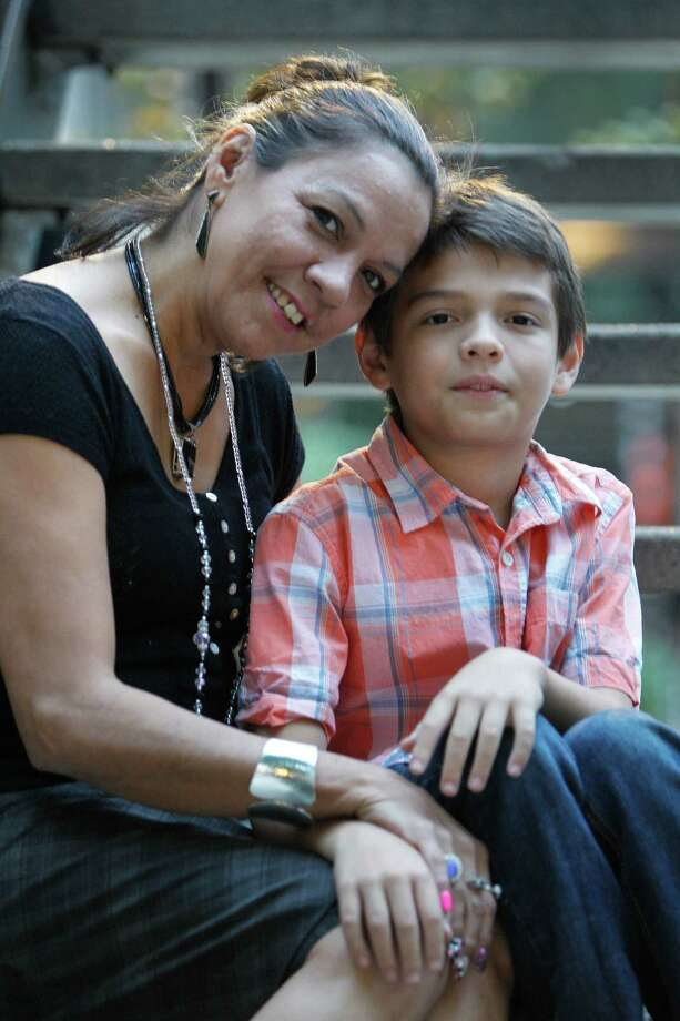 Michelle Hansford, with her son Cyrus, was a CPS parent turned CPS worker, who helps with families in the system. Both were at an event at Santa Maria Hostel, which is where Michelle went into detox when Cyrus was a newborn. Photo: Steve Gonzales, Staff / © 2015 Houston Chronicle