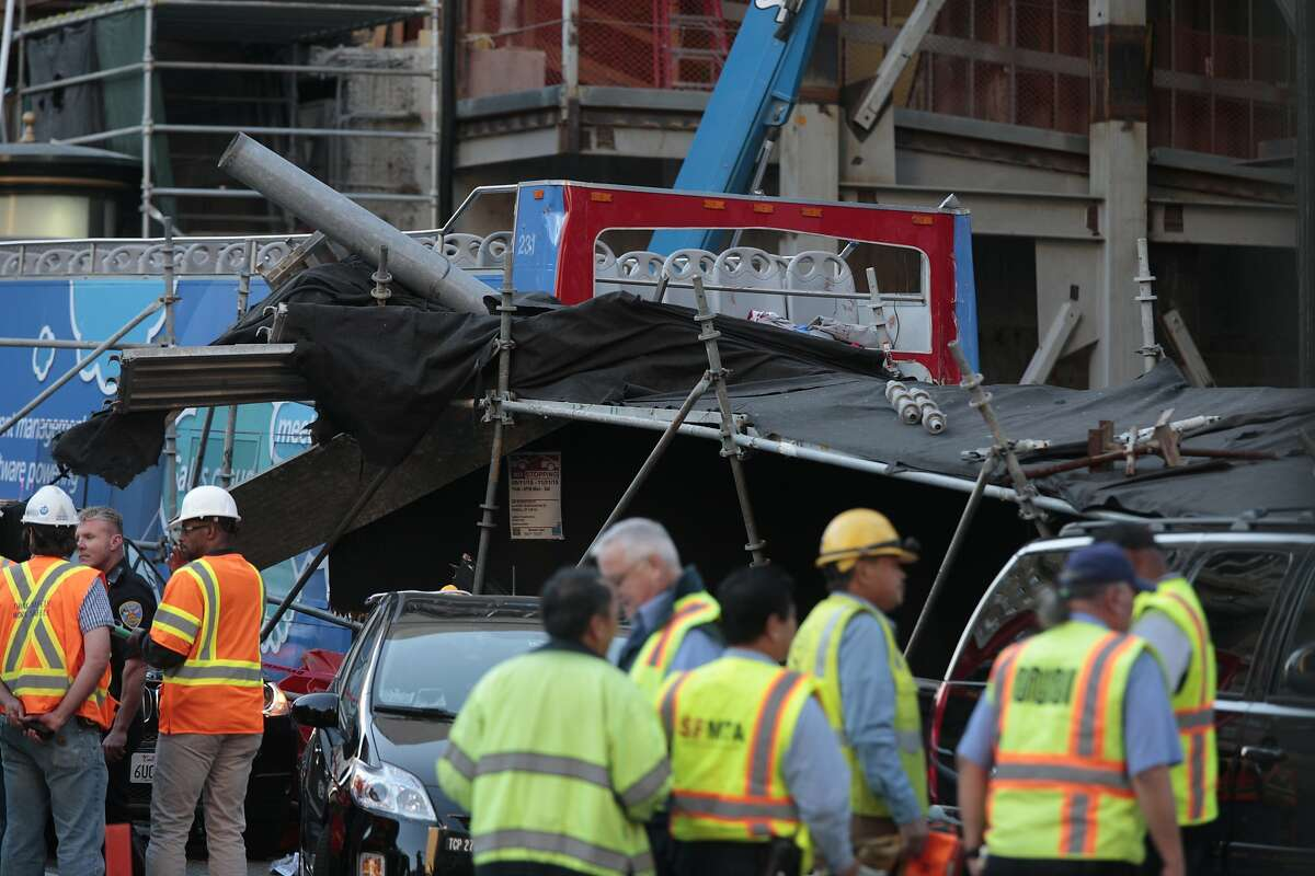 A bus collided with scaffolding on Post street in Union Square on Friday, Nov. 13, 2015 in San Francisco, Calif.