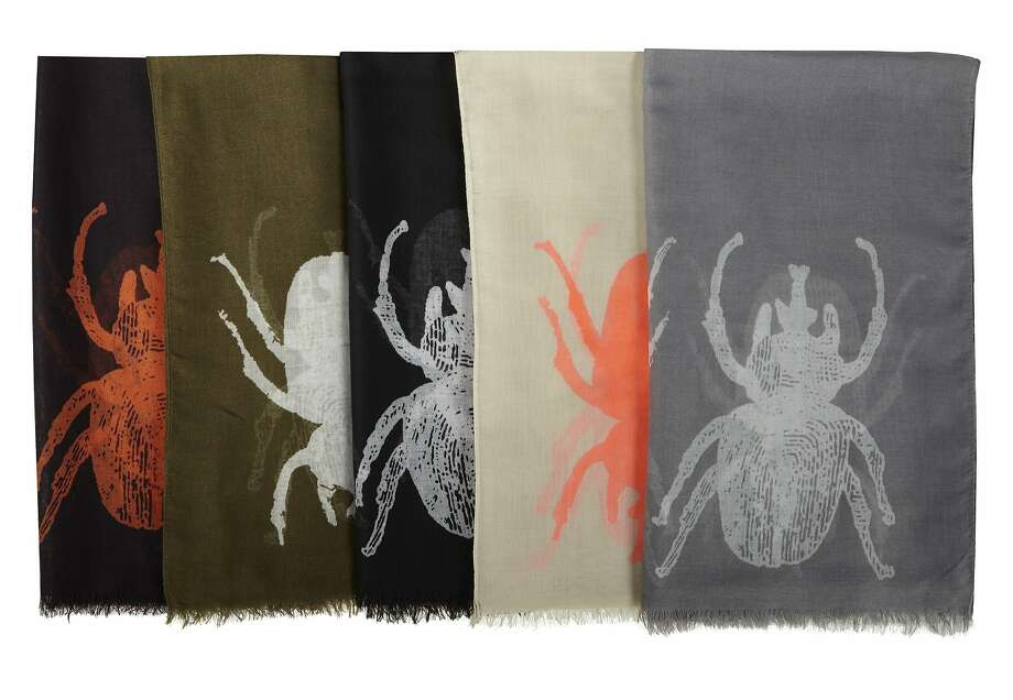 """A lightweight scarf of voile polyester, the """"Siren Scarf"""" with beetle print can be used as an evening shawl in summer, a way to perk up a jeans outfit or as a sarong at the beach. $58, at www.indiahicks.com. Photo: Courtesy Of India Hicks"""