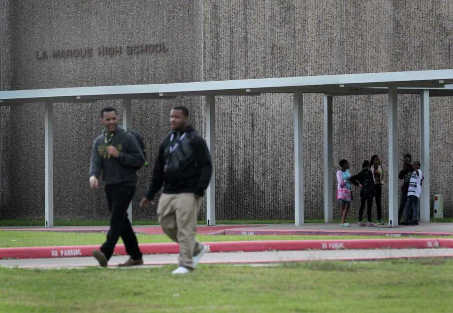 Students leave La Marque High School at the end of the school day Friday. The school district will be shut down July 1 and absorbed by one or more neighboring districts, which will decide whether schools stay open and staff stay employed. Photo: Jon Shapley, Staff / © 2015 Houston Chronicle