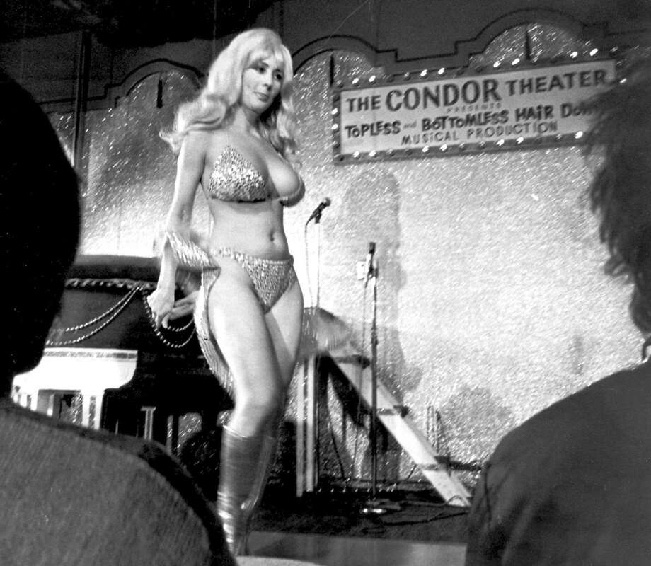 File - In this Sept. 21, 1978 file photo, Carol Doda performs at the Condor Theater in San Francisco. Doda, the legendary stripper who jiggled in America's first topless bar more than 50 years ago, has died in San Francisco of complications related to kidney failure, friends confirmed. She died Monday, Nov. 9, 2015 at age 78. (AP Photo/File) Photo: Associated Press