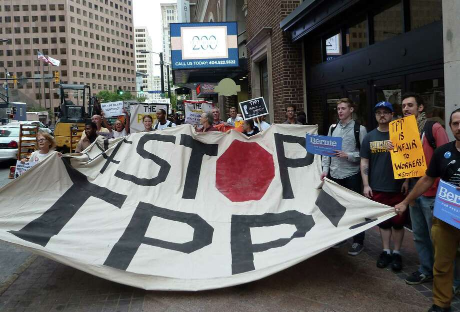 This file photo shows protestors calling for the rejection of the Trans-Pacific Partnership trade deal under negotiation in Atlanta. Photo: PAUL HANDLEY /AFP / Getty Images / AFP