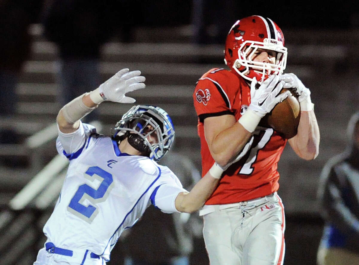 New Canaan defender Ryan O'Connell (7) intercepts a pass in front of Fairfield Ludlowe's Mitch Wykoff.