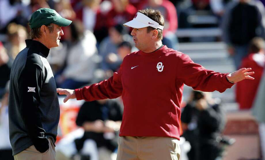 A victory over Oklahoma today not only would keep Baylor well-positioned in the College Football Playoff rankings, but it also would help the Bears stay on course for a third consecutive league crown and allow Art Briles, left, to join Oklahoma's Bob Stoops as the only coaches to win three consecutive Big 12 titles. Photo: Sue Ogrocki, STF / AP