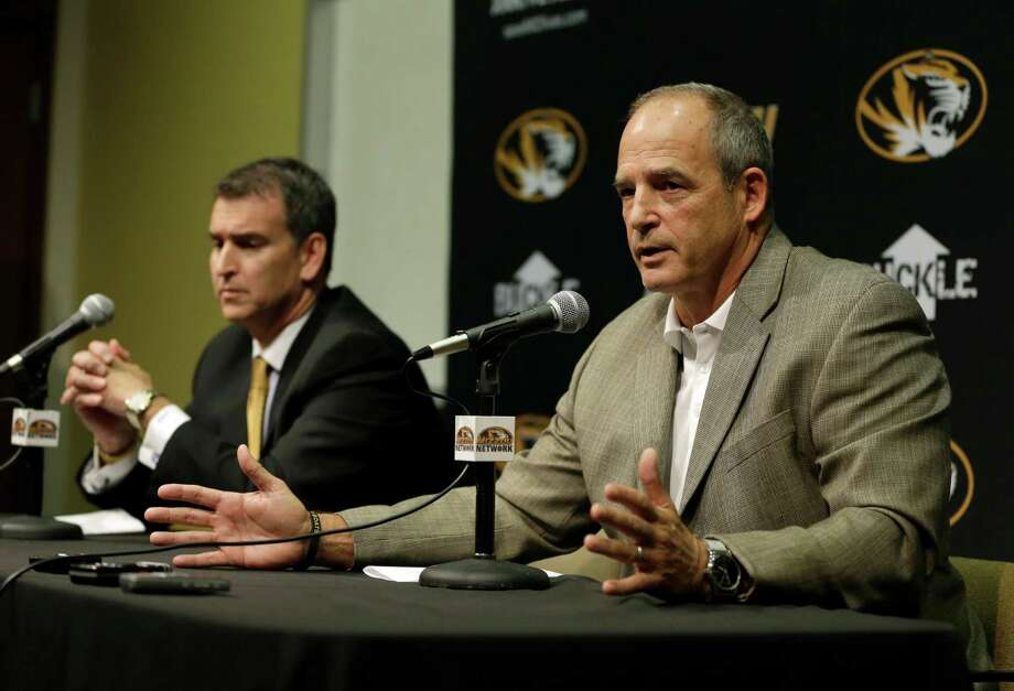 Missouri Athletics Director Mack Rhoades, left, and head football coach Gary Pinkel address the media Monday, Nov. 9, 2015, in Columbia, Mo. Football will resume at Missouri following the resignation of University of Missouri system president Tim Wolfe after several members of the team, pointing to Wolfe's inaction in handling of racial tensions at the school, announced over the weekend that they would not play until the president was gone. (AP Photo/Jeff Roberson) Photo: Jeff Roberson, STF / AP