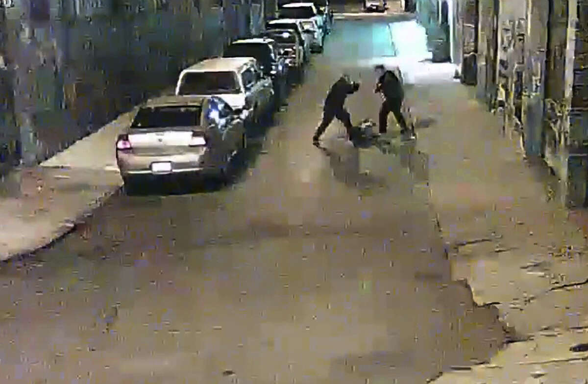 Two Alameda County Sheriff deputies are shown beating a man on a street in San Francisco's Mission District in a video screen grab.