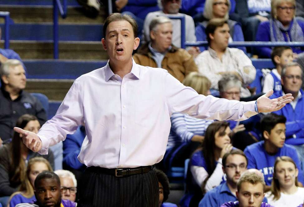 Albany head coach Will Brown questions a call during an NCAA college basketball game against Kentucky, Friday, Nov. 13, 2015, in Lexington, Ky. (AP Photo/James Crisp) ORG XMIT: KYJC113