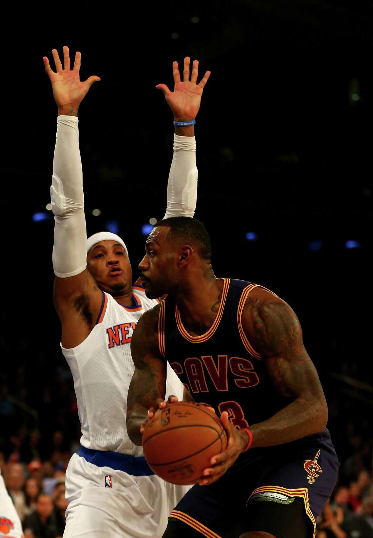NEW YORK, NY - NOVEMBER 13: LeBron James #23 of the Cleveland Cavaliers heads for the net as Carmelo Anthony #7 of the New York Knicks defends in the first quarter at Madison Square Garden on November 13, 2015 in New York City.NOTE TO USER: User expressly acknowledges and agrees that, by downloading and/or using this photograph, user is consenting to the terms and conditions of the Getty Images License Agreement. (Photo by Elsa/Getty Images) ORG XMIT: 575728163