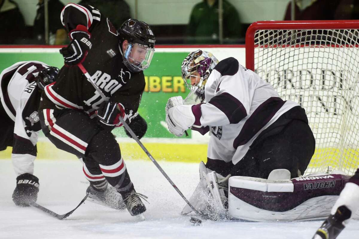 Brown's Max Willman, left, works the puck into the net as Union's goaltender Alex Sakellaropoulos defends during their hockey game on Friday, Nov. 13, 2015, at Messa Rink in Schenectady, N.Y. The overtime goal made Brown the winner with a score of 3-2. (Cindy Schultz / Times Union)