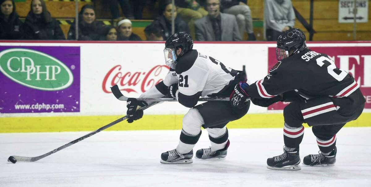 Union's Mike Vecchione, left, controls the puck as Brown's Brady Schoo defends during their hockey game on Friday, Nov. 13, 2015, at Messa Rink in Schenectady, N.Y. (Cindy Schultz / Times Union)
