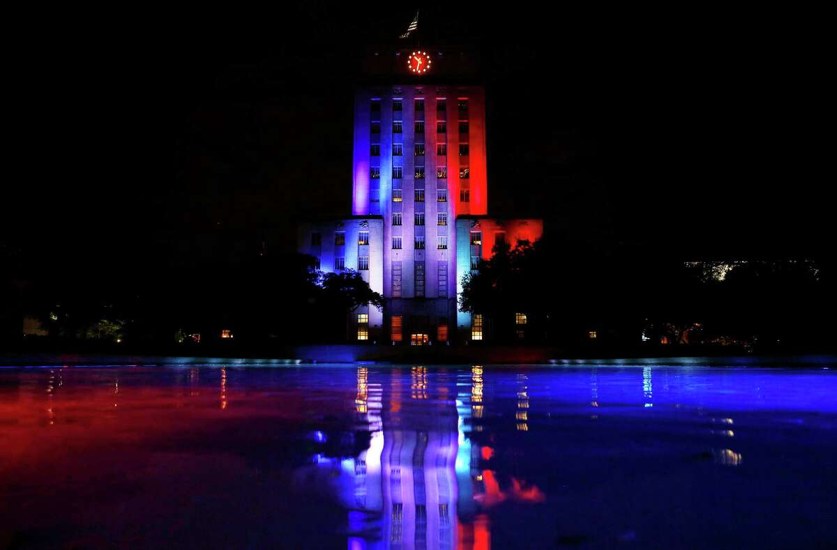 Houston's City Hall building is lit up in the colors of the French flag, Friday, Nov. 13, 2015. Over 100 people are reported dead in a series of attacks in Paris Friday.