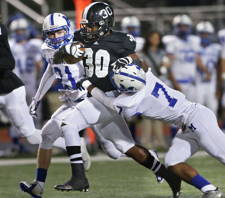 Knight running back Travell Lumpkin makes yardage up the middle with Brahmas Will Ellis (21) and Charles Henderson catching up to stop him as Steele plays MacArthur at Lehnhoff  Stadium in 6A bidistrict action on November 13, 2015. Photo: TOM REEL, STAFF / SAN ANTONIO EXPRESS-NEWS / 2015 SAN ANTONIO EXPRESS-NEWS