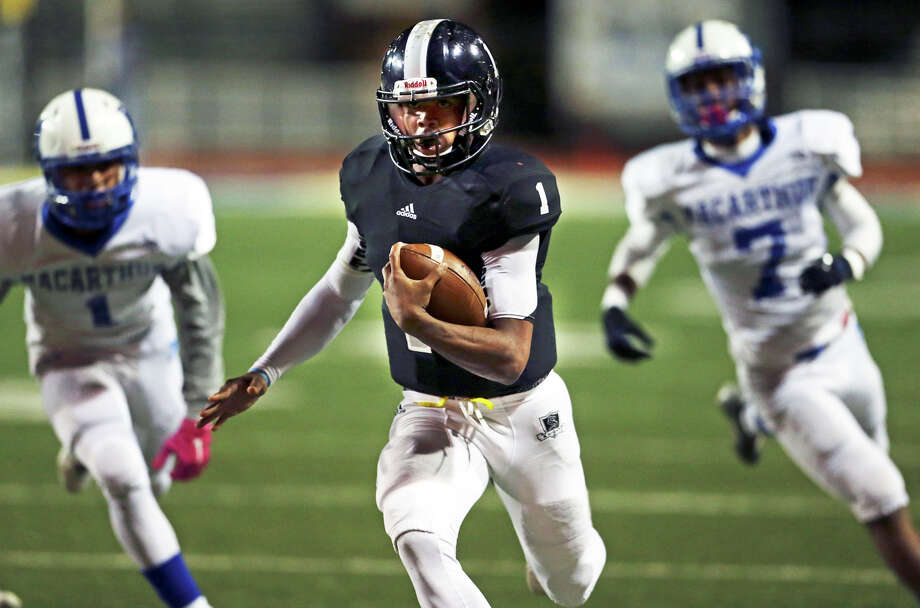 Knight quarterback Xavier Martin heads down the sideline for a long first half touchdown as Steele plays MacArthur at Lehnhoff  Stadium in 6A bidistrict action on November 13, 2015. Photo: TOM REEL, STAFF / SAN ANTONIO EXPRESS-NEWS / 2015 SAN ANTONIO EXPRESS-NEWS