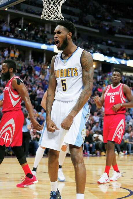Forward Will Barton had reason to shout after a second-half dunk helped the Nuggets beat the Rockets for the second time in the young season. Barton had a career-high 26 points. Photo: Jack Dempsey, FRE / FR42408 AP