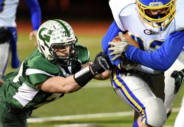Greenwich's Reese Cristaldi, left, works to bring down Gouverneur's Cody Orr during their quarterfinal football game on Friday, Nov. 13, 2015, at Mohonasen High in Rotterdam, N.Y. (Cindy Schultz / Times Union) Photo: Cindy Schultz / 10034218A