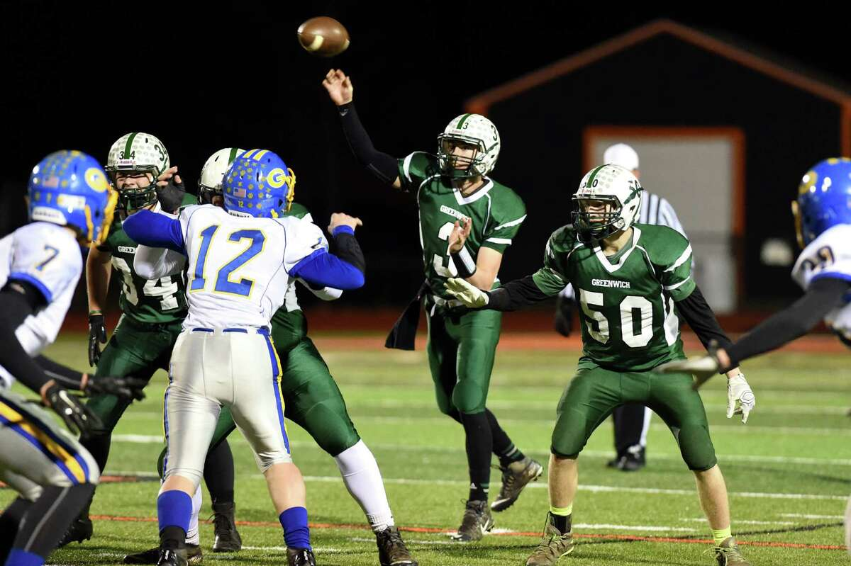 Greenwich's quarterback Lukas Whitehouse, center, throws a pass during their quarterfinal football game on Friday, Nov. 13, 2015, at Mohonasen High in Rotterdam, N.Y. (Cindy Schultz / Times Union)