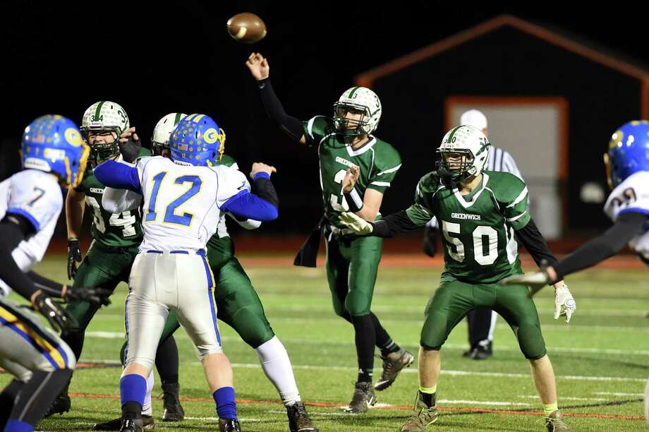 Greenwich's quarterback Lukas Whitehouse, center, throws a pass during their quarterfinal football game on Friday, Nov. 13, 2015, at Mohonasen High in Rotterdam, N.Y. (Cindy Schultz / Times Union) Photo: Cindy Schultz / 10034218A