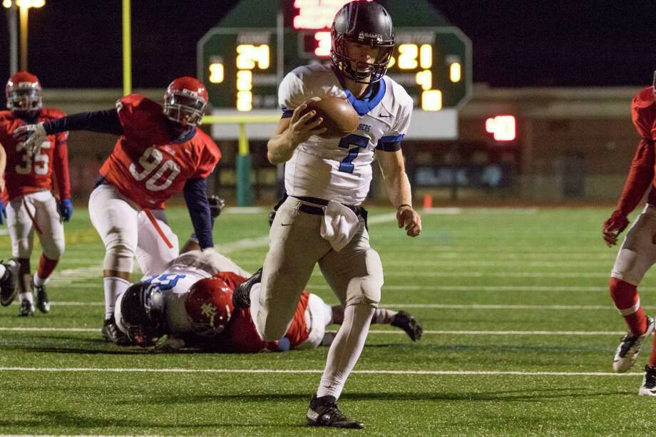 Clear Springs quarterback William McBride scores on a 7-yard run late in the fourth quarter to give the Chargers a 28-24 victory over Alief Taylor in their Class 6A Division I bi-district game at Crump Stadium. Photo: Joe Buvid, Freelance / © 2015 Joe Buvid