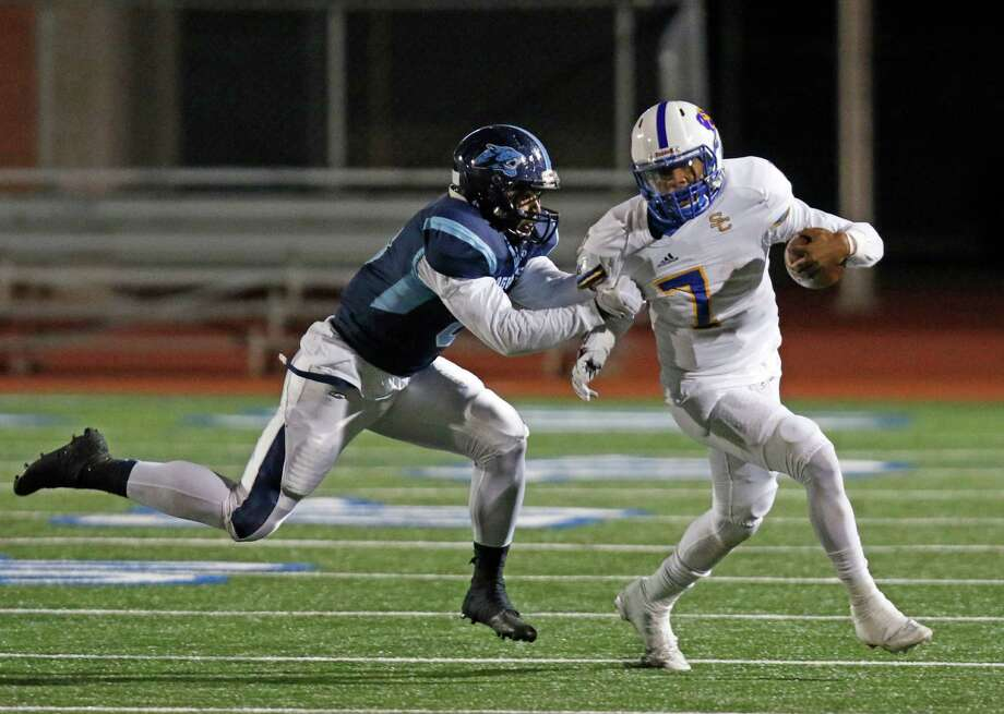 Clemens QB Frank Harris is sacked by Johnson's StevinFields sacks Class 6A Division II bidistrict football game between Johnson and Clemens at Heroes Stadium on Friday, November 13, 2015. Photo: Ron Cortes, Photographer / For The San Anton / Express-News