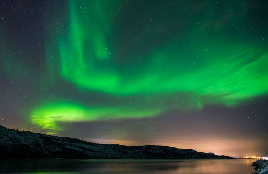 The Aurora Borealis or Northern Lights illuminate the night sky on November 12, 2015 near the town of Kirkenes in northern Norway. Photo: Jonathan Nackstrand, AFP / Getty Images