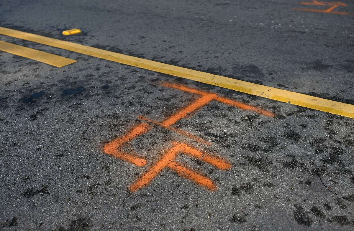 Tire position markings indicate where Soren Kim's 3-year-old daughter Grace was struck by a car in San Francisco on November 13, 2015. Since Grace has been hospitalized, three other people - including two 12-year-old boys - have been seriously injured on San Francisco streets.