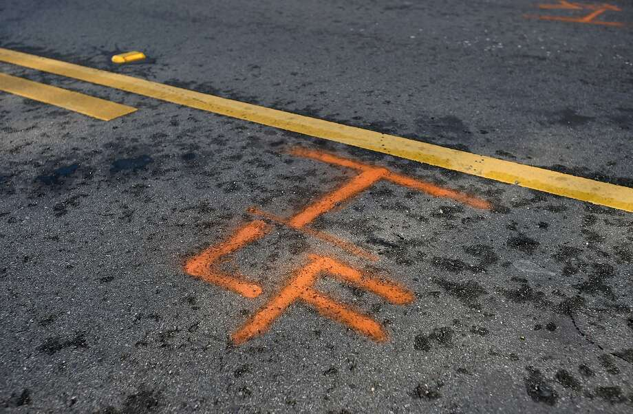 Tire position markings indicate where Soren Kim's 3-year-old daughter Grace was struck by a car in San Francisco on November 13, 2015. Since Grace has been hospitalized, three other people - including two 12-year-old boys - have been seriously injured on San Francisco streets. Photo: JOSH EDELSON / SAN FRANCISCO CHR